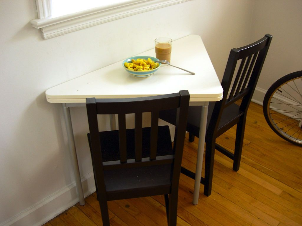 Triangle Shaped Small Dining Tables And Black Chairs On Wooden Floor Near Bicycle Ikea TableWooden
