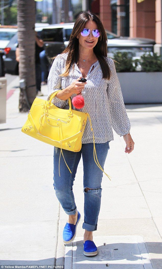 872617cac92 Bright bag  Kyle Richards made sure to bring the sunshine back with her in  abundance in Beverly Hills on Tuesday