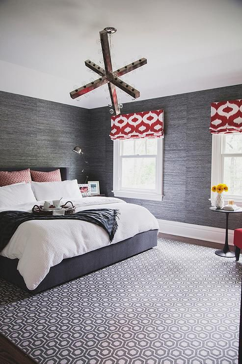 Charcoal Gray Bedroom With Red Accents Features Walls Clad In Charcoal Gray Grasscloth Lined With A Bedroom Red Feature Wall Bedroom Grey Wallpaper Accent Wall