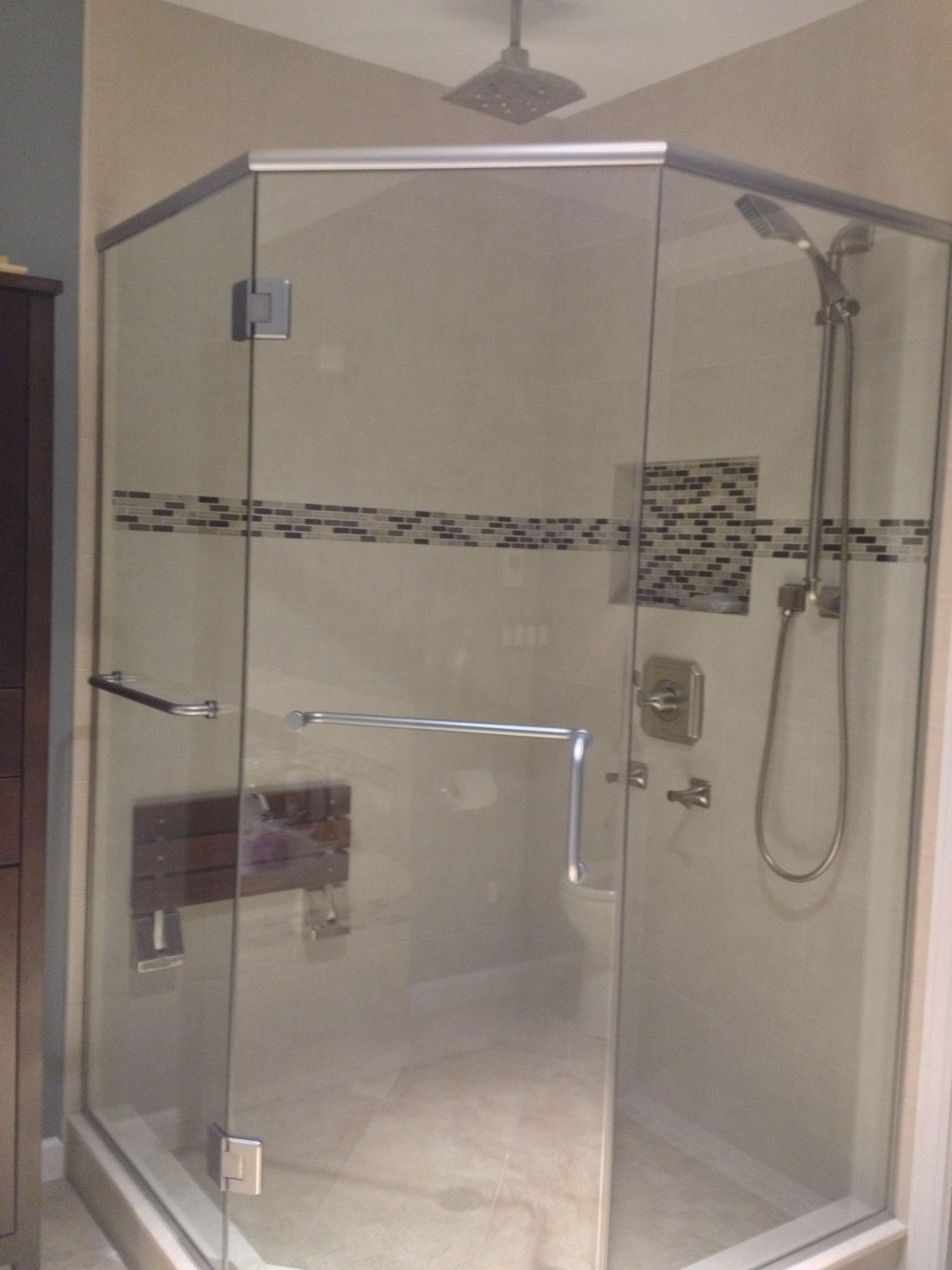 Neo angle shower with teak fold up seat, tiled product niche with ...