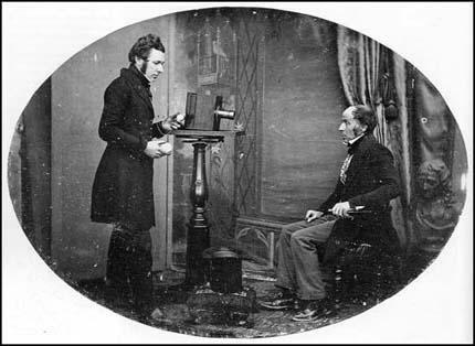 Jabez Hogg, an operator for Richard Beard, taking a daguerreotype portrait of Mr Johnson in London (c1842)