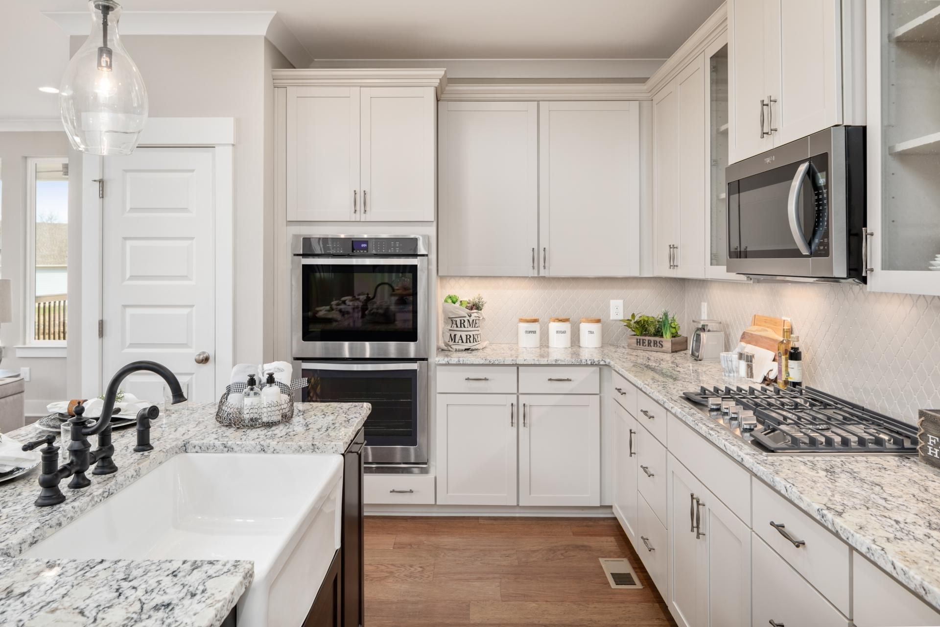 Drees Homes Kinsley kitchen with farmhouse sink, a diamond