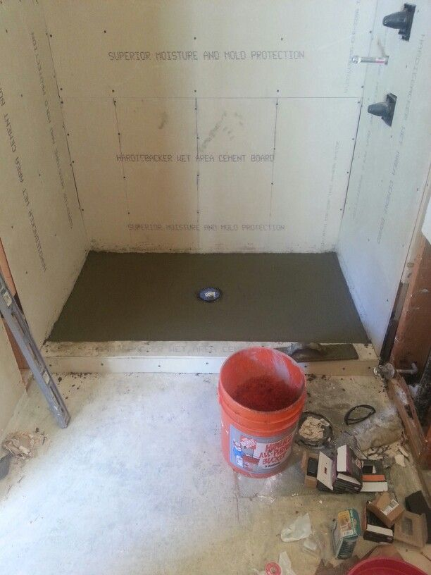 Deck Mud Over The Hot Mop To Insure Proper Flow And Tile Adhesion Bathrooms Remodel Tiles Remodel