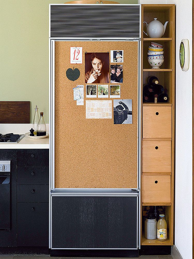 Put cork board on your fridge to easily hang photos and prints