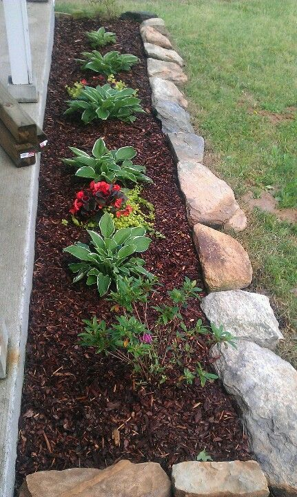 Natural rock for flower bed border