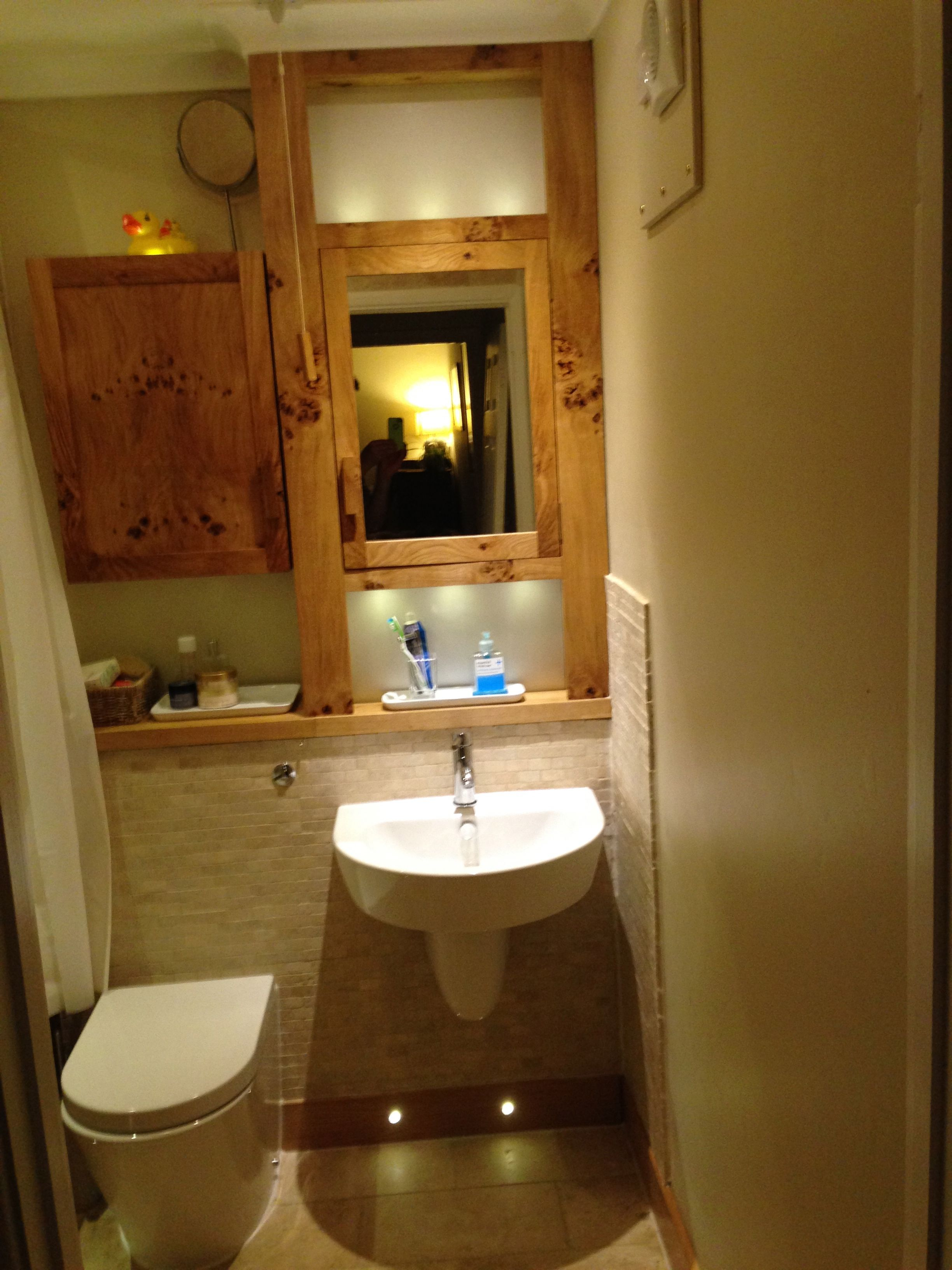 Bathroom: Wall mounted basin, back to wall WC, oak built cabinets ...