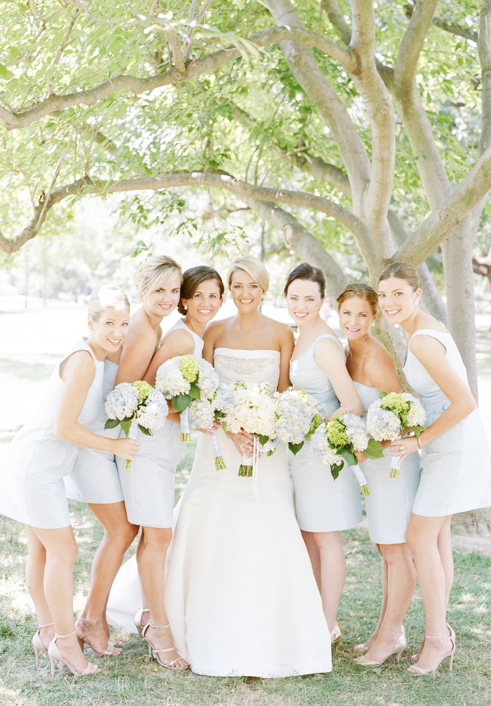 Such a gorgeous setting for a shot with your bridesmaids. Love the blue bridesmaids dresses! | Photo by Sweet Tea Photography