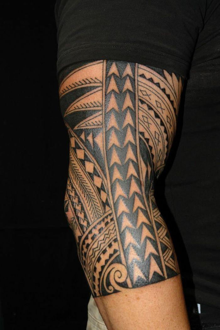 foto de tatouage manchette ethnique, bras et avant bras tatoués, symboles ...