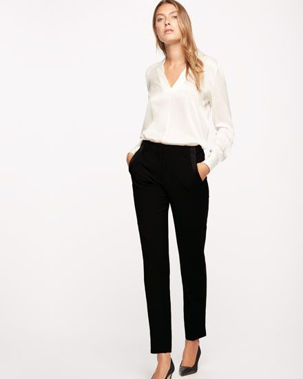 These tuxedo trousers are inspired by model and editorial muse Guinevere Van Seenus. Made from Italian stretch wool, the slim fit elongates the leg while providing a contemporary feel. Features include a contrast satin back crepe side slit, an elegant V-split at the centreback waist and a satin binding interior. Pair with court shoes for a polished eveningwear look.