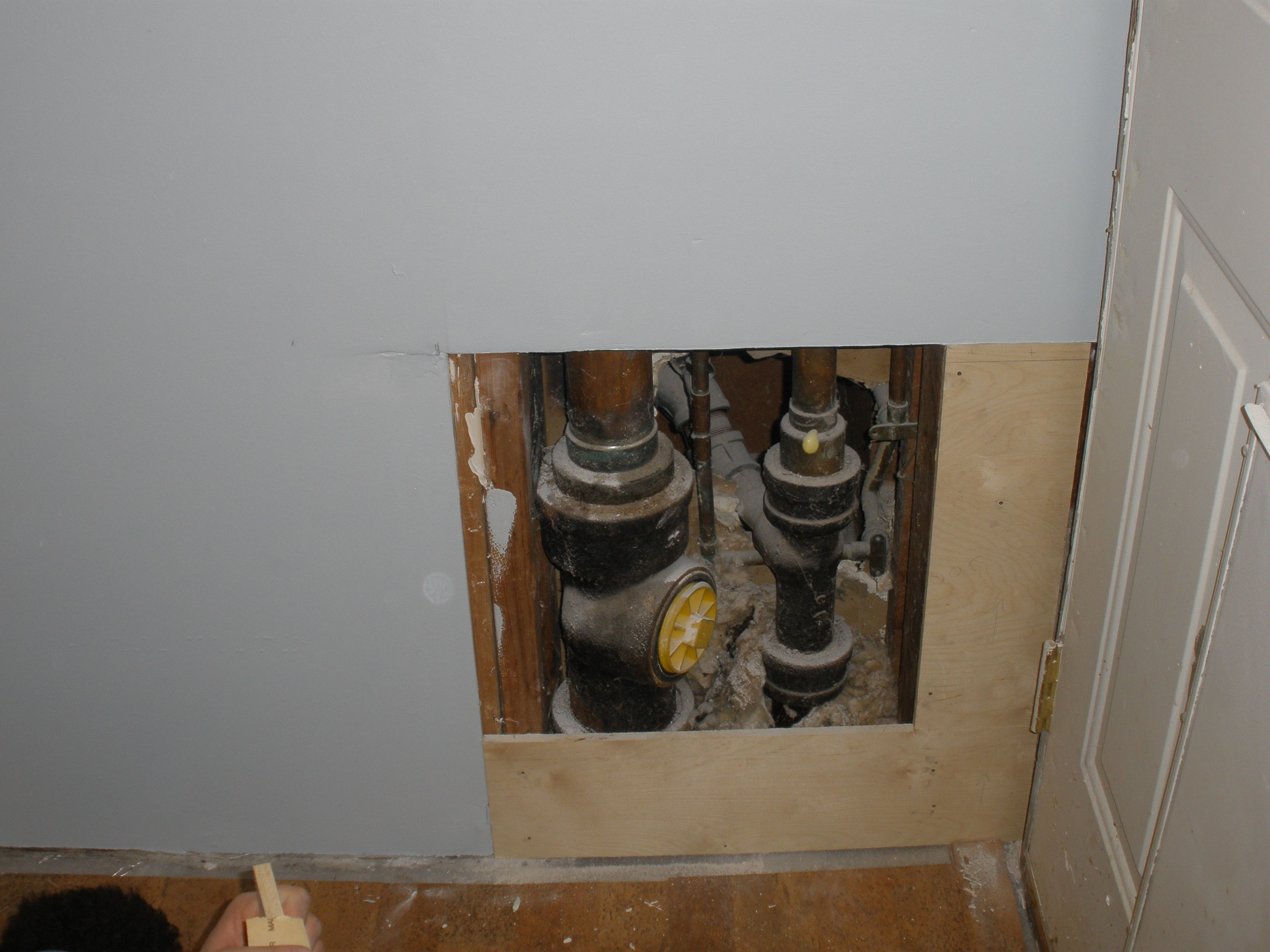Remodelaholic Hiding Plumbing Access With Wainscoting Wainscoting Plumbing Wainscoting Wall