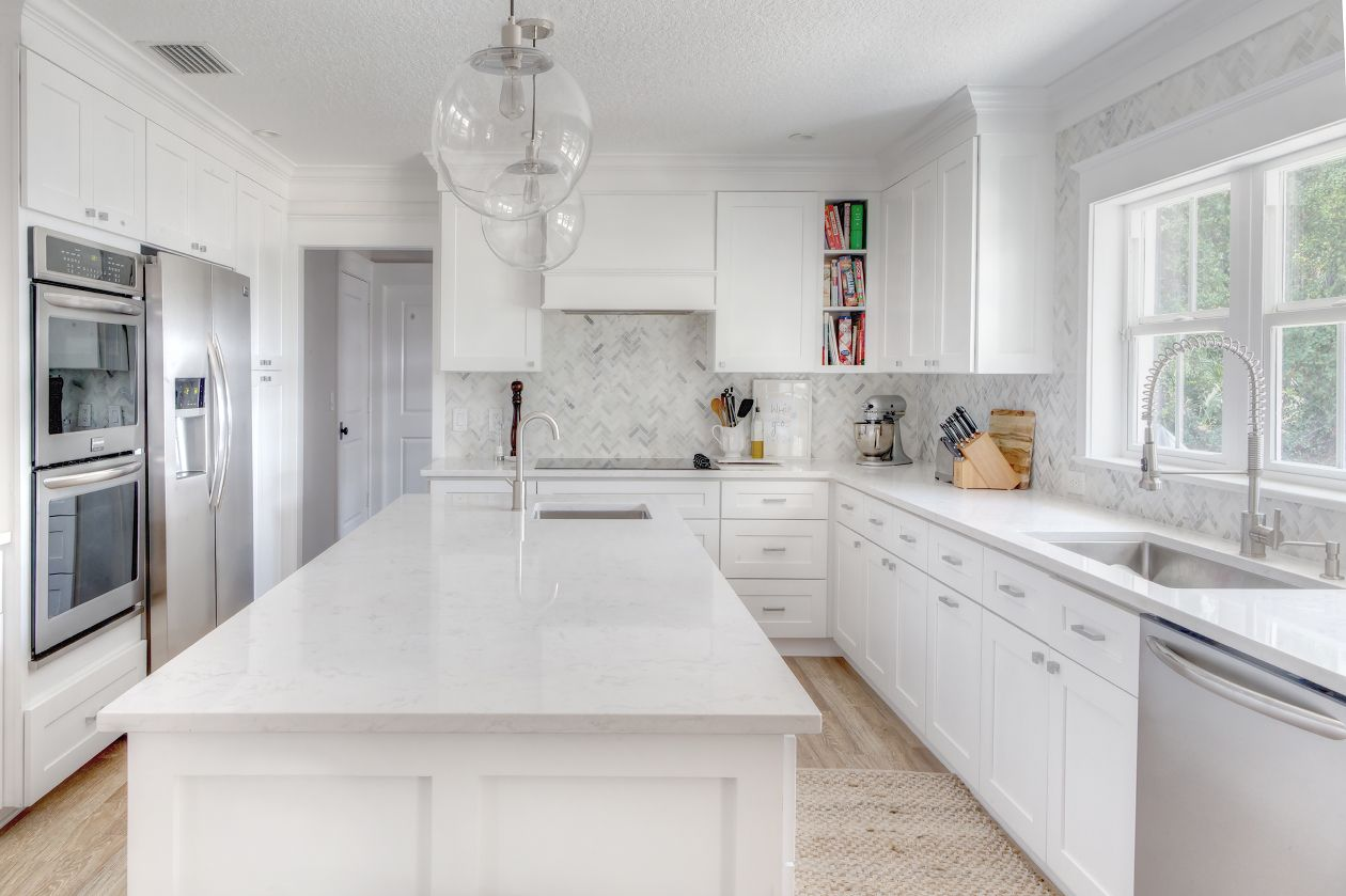 The Kitchen Roseland Project White And Grey Cabinets Cambria Torquay Quartz Countertop Marble Herringbone Backsplash