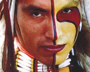 Returning the Gaze (detail). Assiniboine dancer Kevin Haywahe with face paint © Jeff Thomas