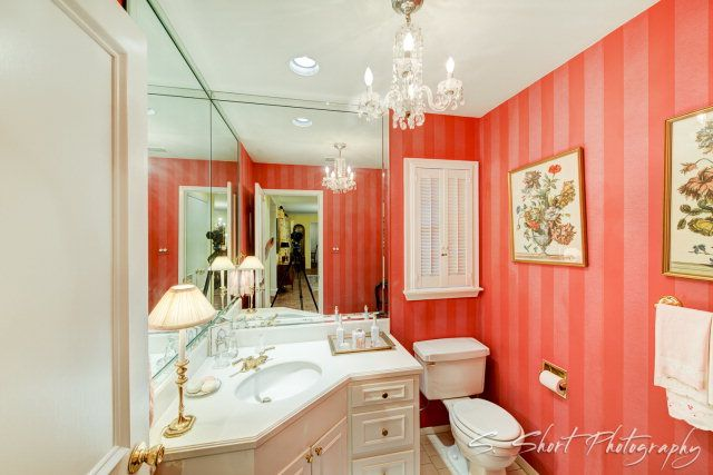 Love the elegance of the #chandelier in this #bathroom