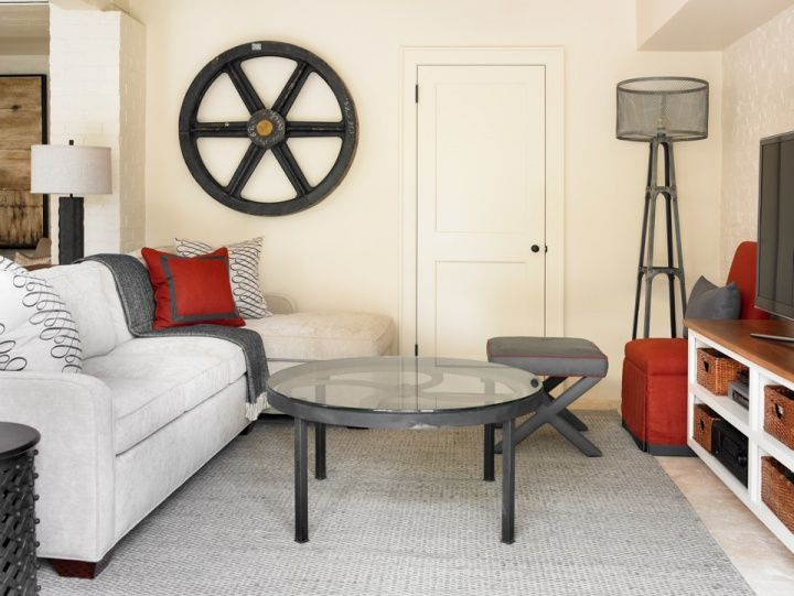 Courtney Giles Interiors Fun gray & red media room with gray sofa