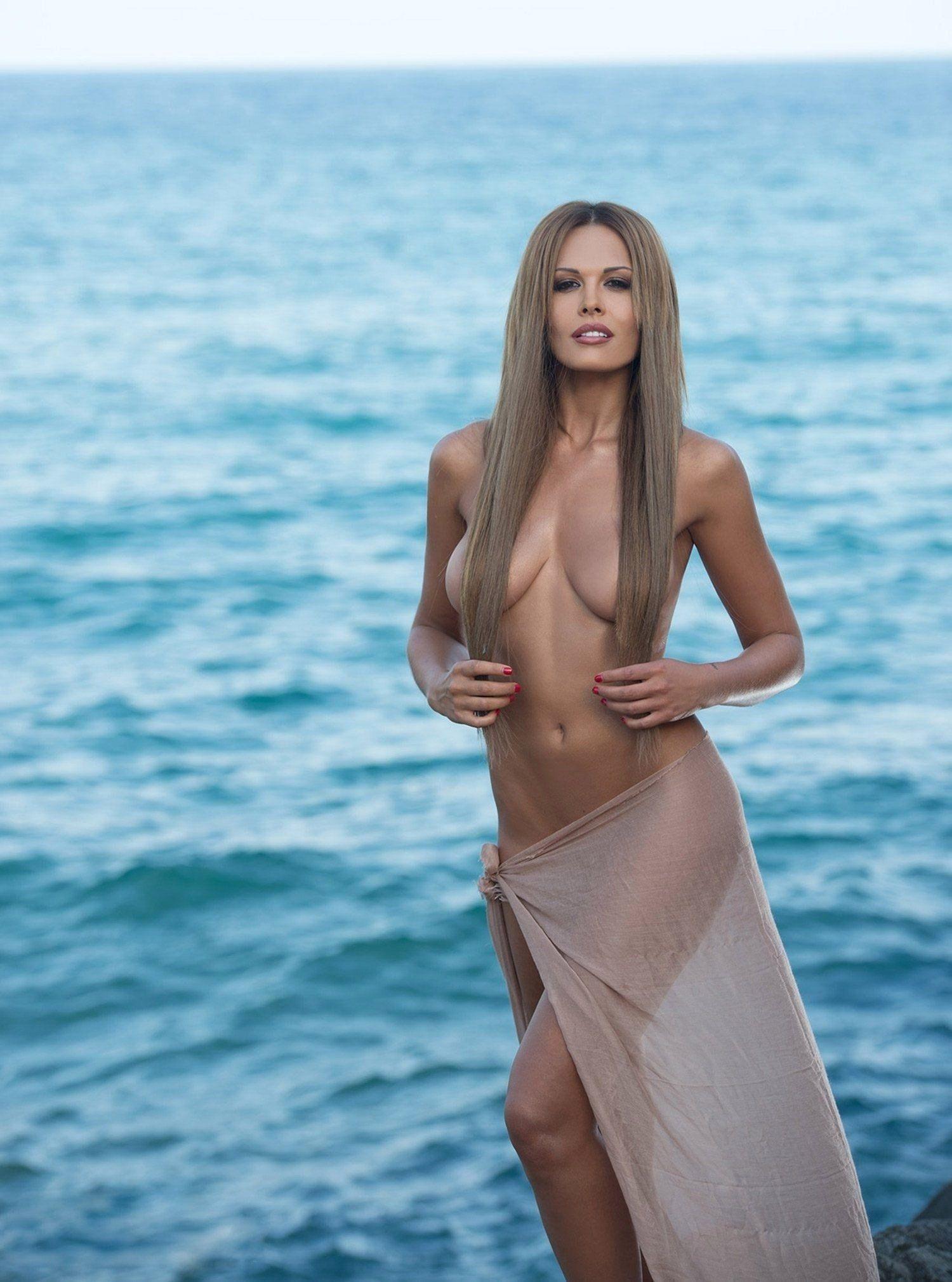 Topless girl on beach australia