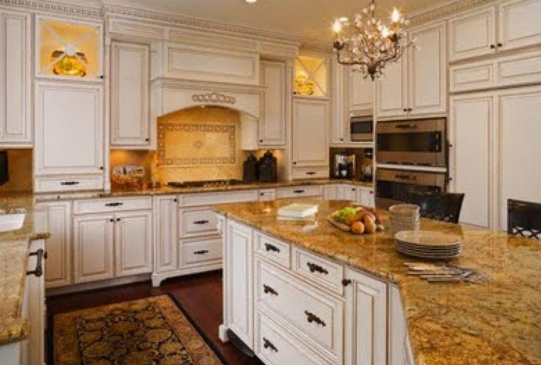 light cabinets - granite countertops , dark floors ...