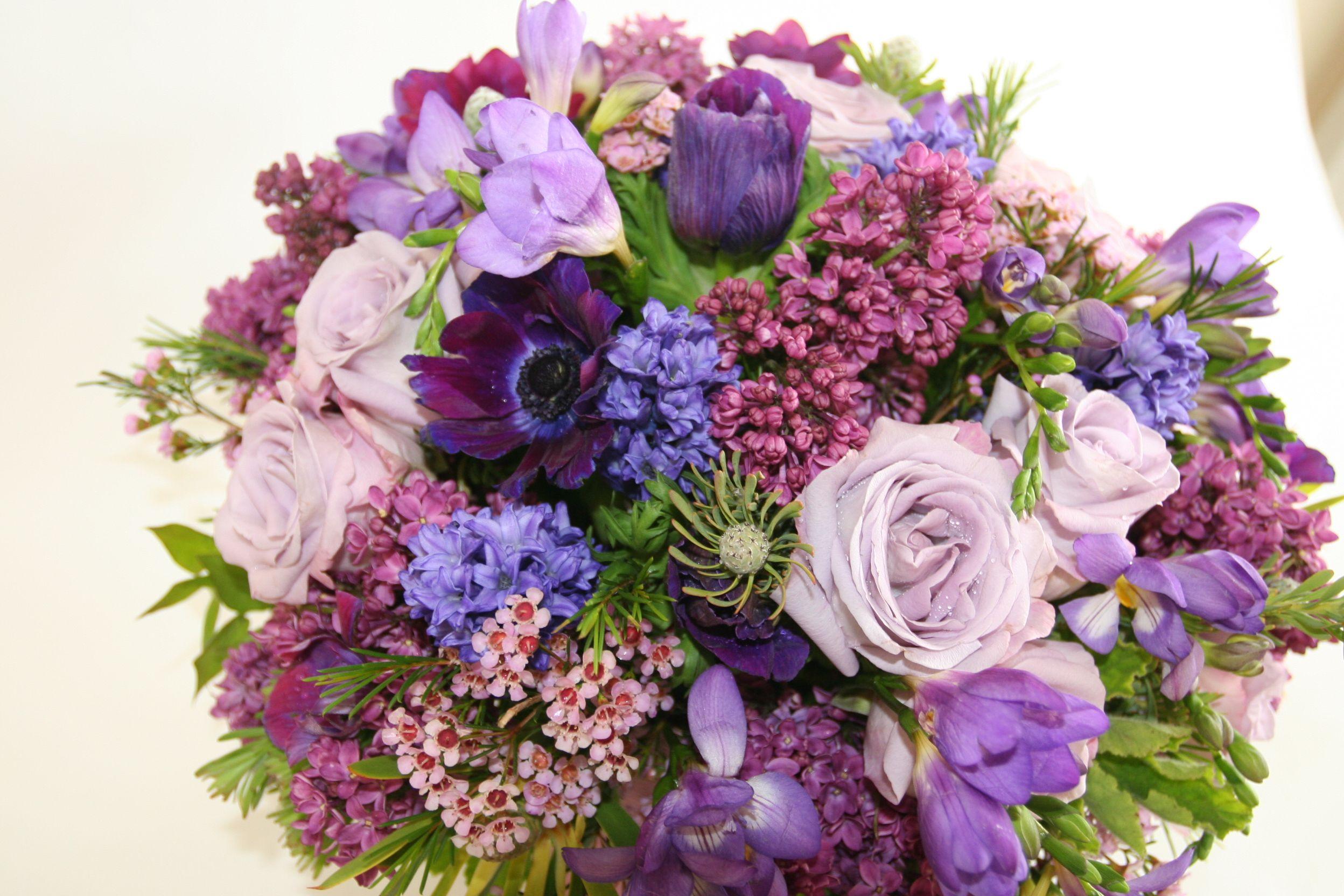 Anemones lilacs hyacinth roses freesia waxflower