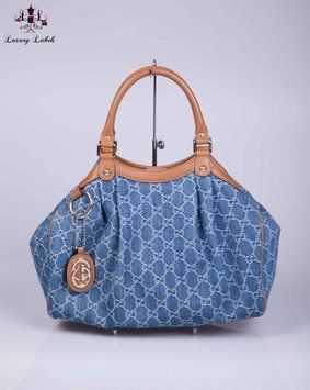 39500ba6df3d Gucci Blue Denim Gg Sukey Medium Tote Bag. Get one of the hottest styles of  the season! The Gucci Blue Denim Gg Sukey Medium Tote Bag is a top 10  member ...