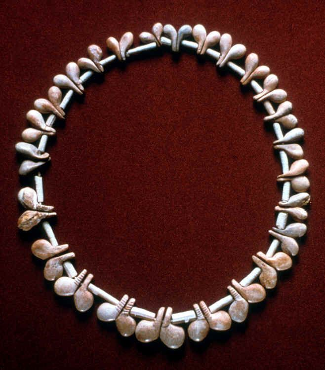 NATUFIAN BONE & TOOTH NECKLACE  --  12,500-10,800 BCE  --  Excavated from a burial site at El Wad Terrace, Mt. Carmel, Israel  --  Natufian burial practices show sophistication of ritual & symbolic activity, including personal adornments & inclusion of animal products/skeletons in previously unknown intensity.  Perhaps most elaborate society of Epipalaeolithic period.