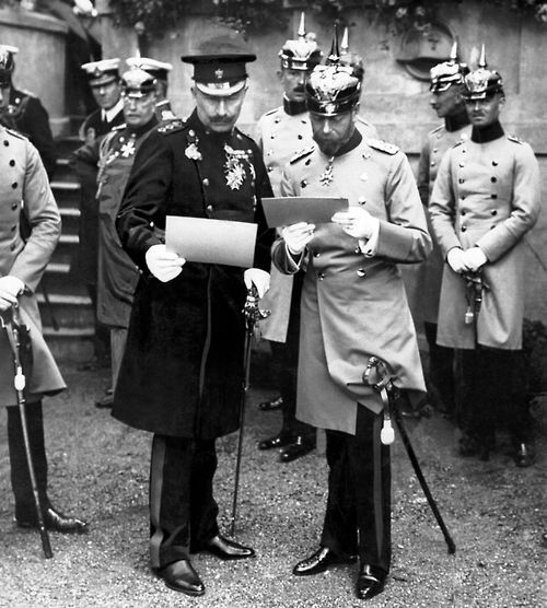King George V accompanied by his cousin Kaiser Wilhelm II of German during his visit to Berlin in May 1913.