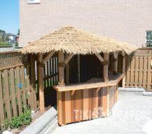 Nice tiki bar in the corner of a pool deck tiki for Above ground pool decks with bar