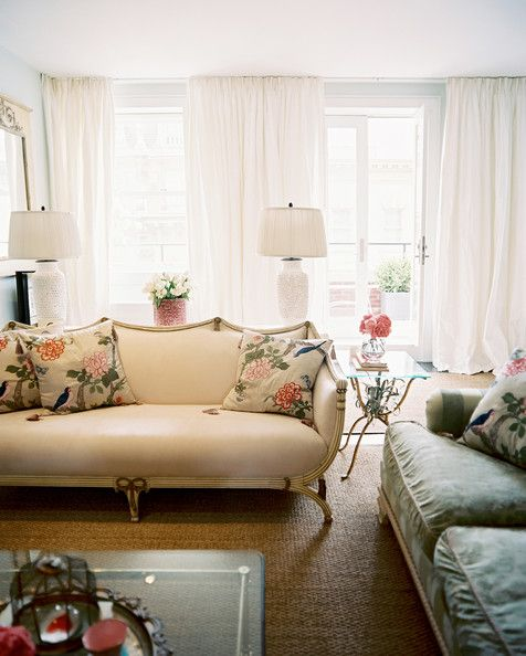 Lynn Nigro Photo   A Pair Of White Lamps Behind A Beige Settee With Floral  Pillows