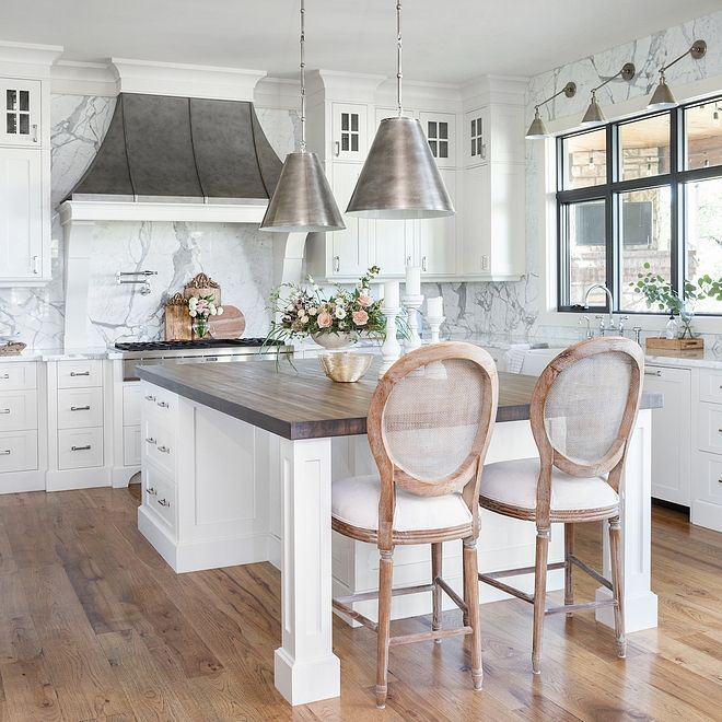 White French kitchen with zinc French hood and Statuario marble