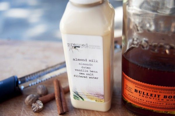 Bourbon Almond Milk Punch   Using a high-rye bourbon like Bulleit means a less cloyingly sweet flavor. Combined with luscious almond milk, and a touch of spice, this milky punch is surprisingly refreshing.     1 bottle almond milk   4 oz bourbon   1/4 tsp cinnamon   1/4 tsp nutmeg   1 tablespoon agave nectar     Shake all of the ingredients and pour over ice and top with some nutmeg.