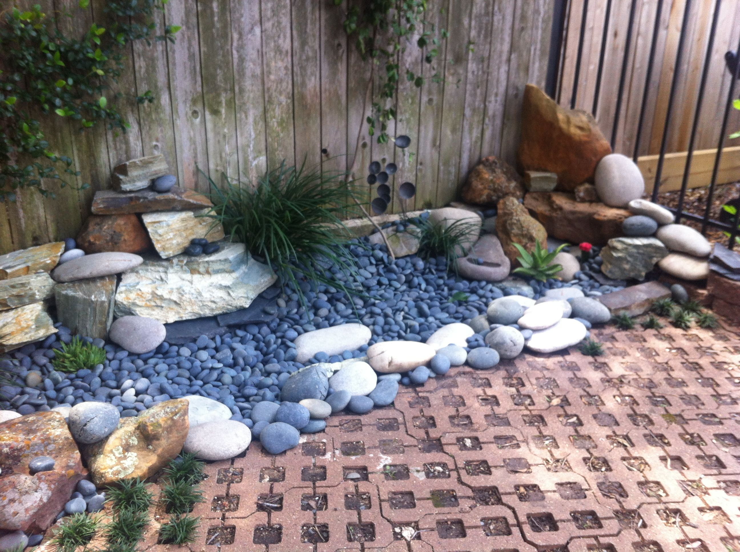Dry river bed landscape rocks rocks rock rocks for Rock garden bed ideas