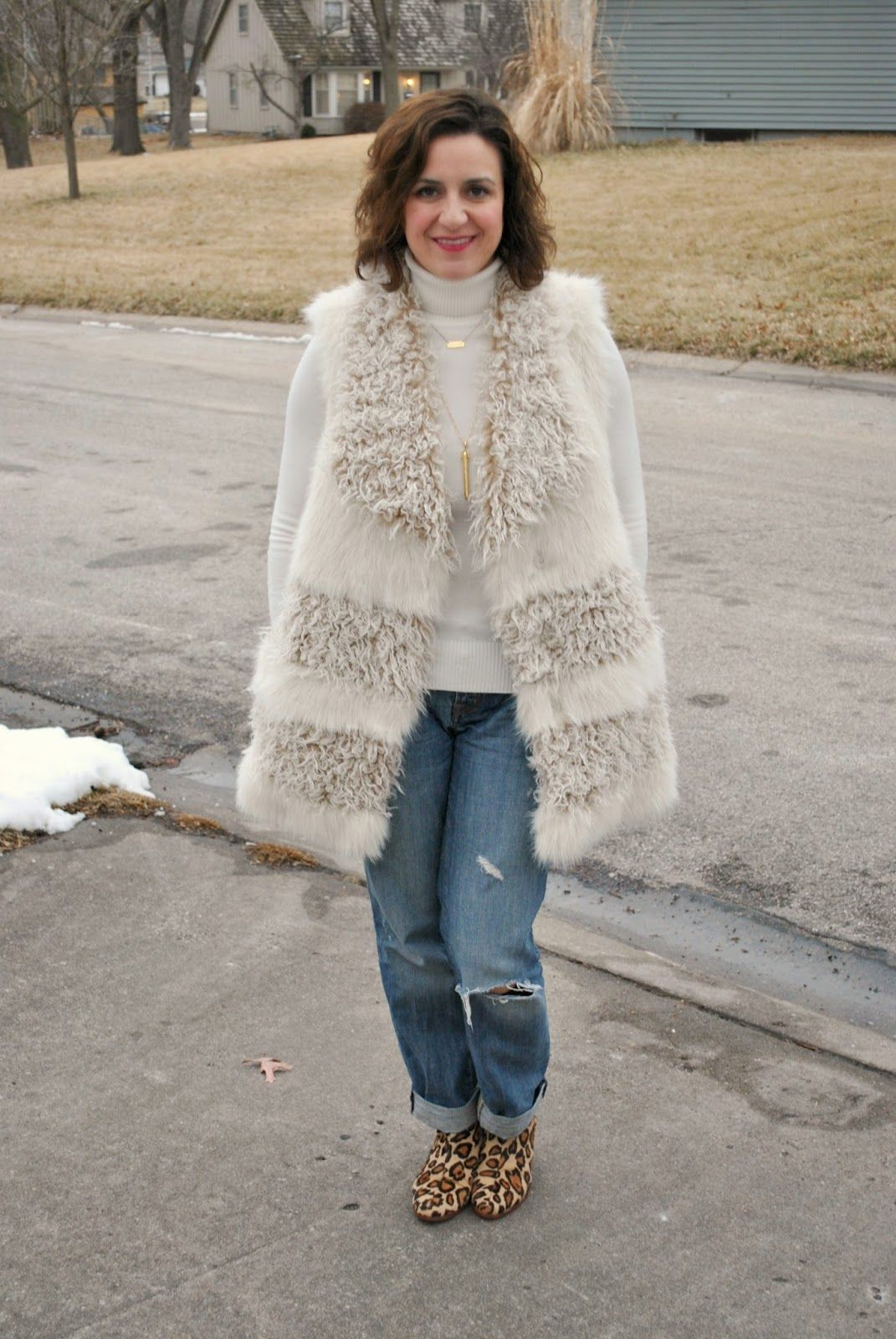 Faux fur vest, cream sweater, boyfriend jeans, and leopard print booties. A cozy chic look! http://akstylemyway.blogspot.com/