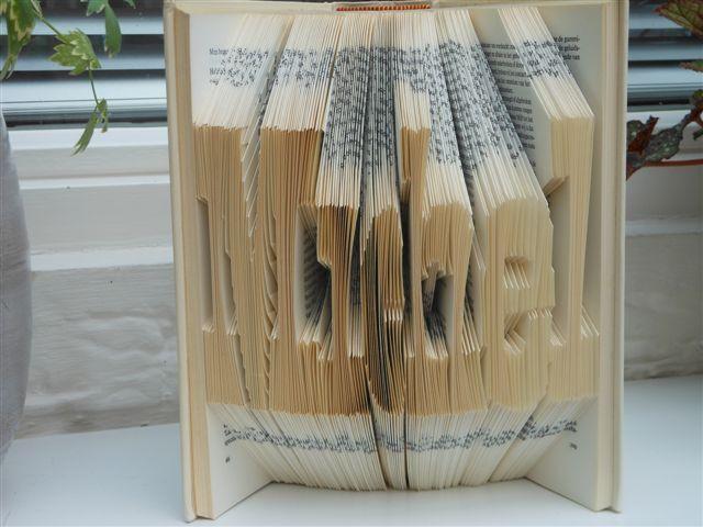 Boek invouwen met de naam Michel