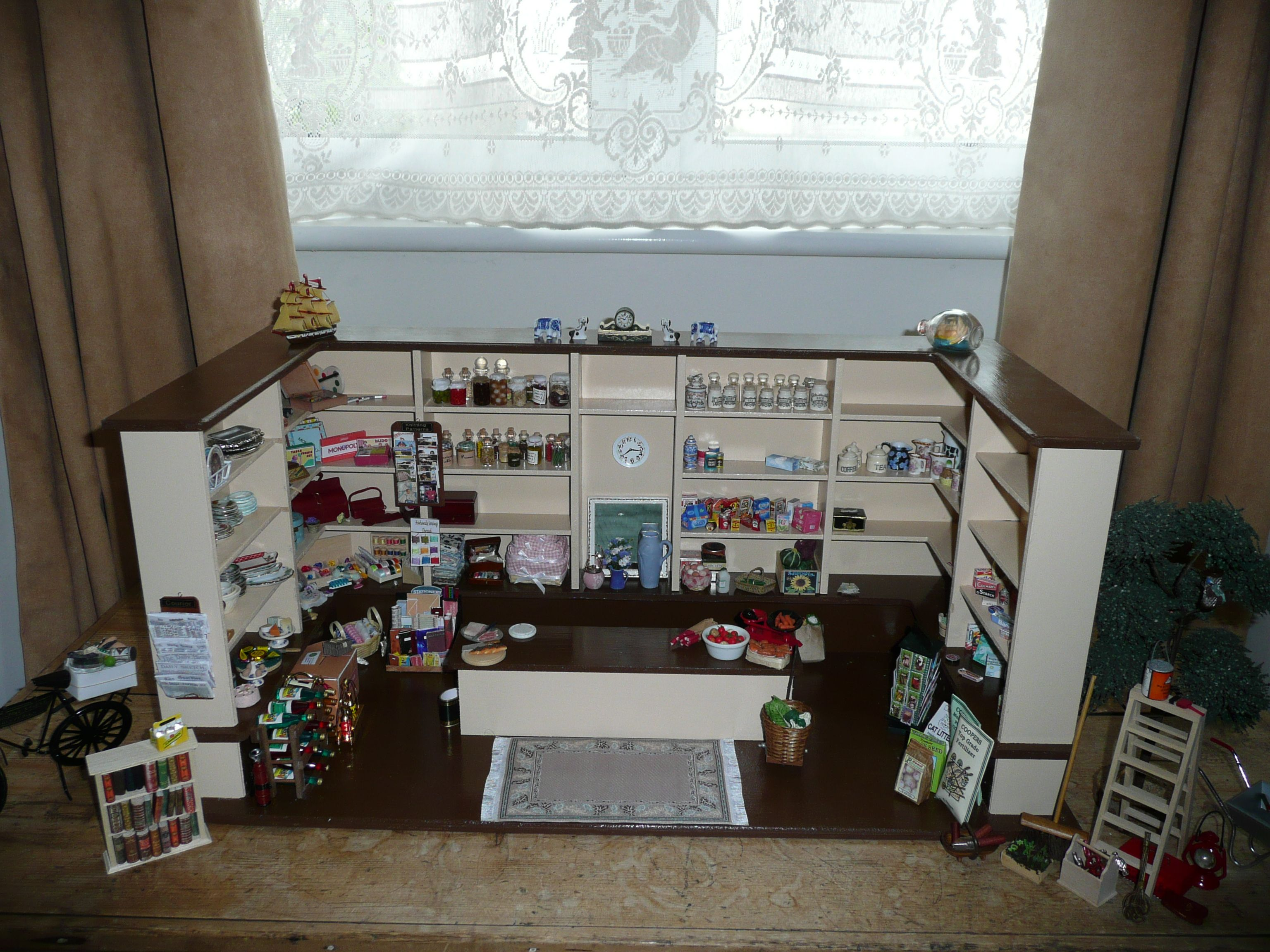 What a brilliant idea to store those extras! This way you can go shopping for essentials in your own miniature shop. I love it!