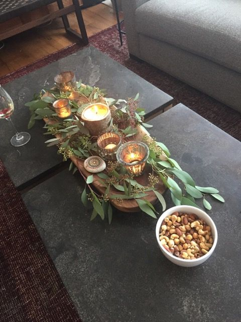 Greens, candles and painted rocks for a boho baby shower!
