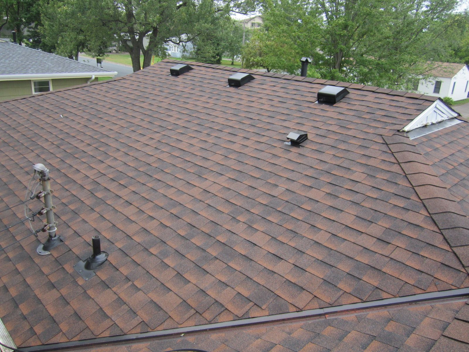 Best Asphalt Shingle Roof In Fridley Mn Gaf Hickory Color 400 x 300