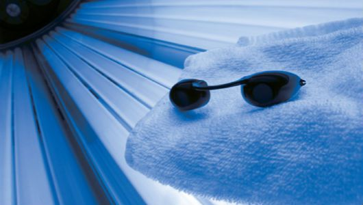 At least 20 states are considering legislation that would make tanning beds off-limits to minors.
