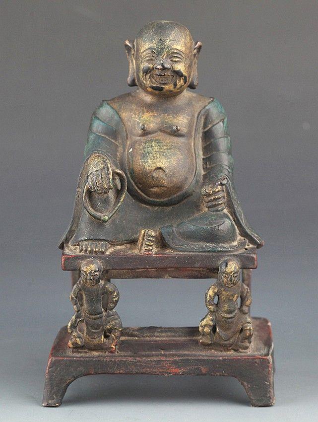 A BRONZE FIGURE OF MAITREYA BUDDHA