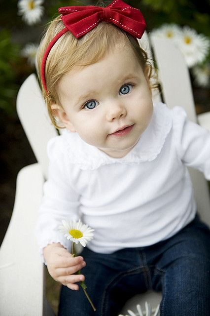 baby girl with a flower