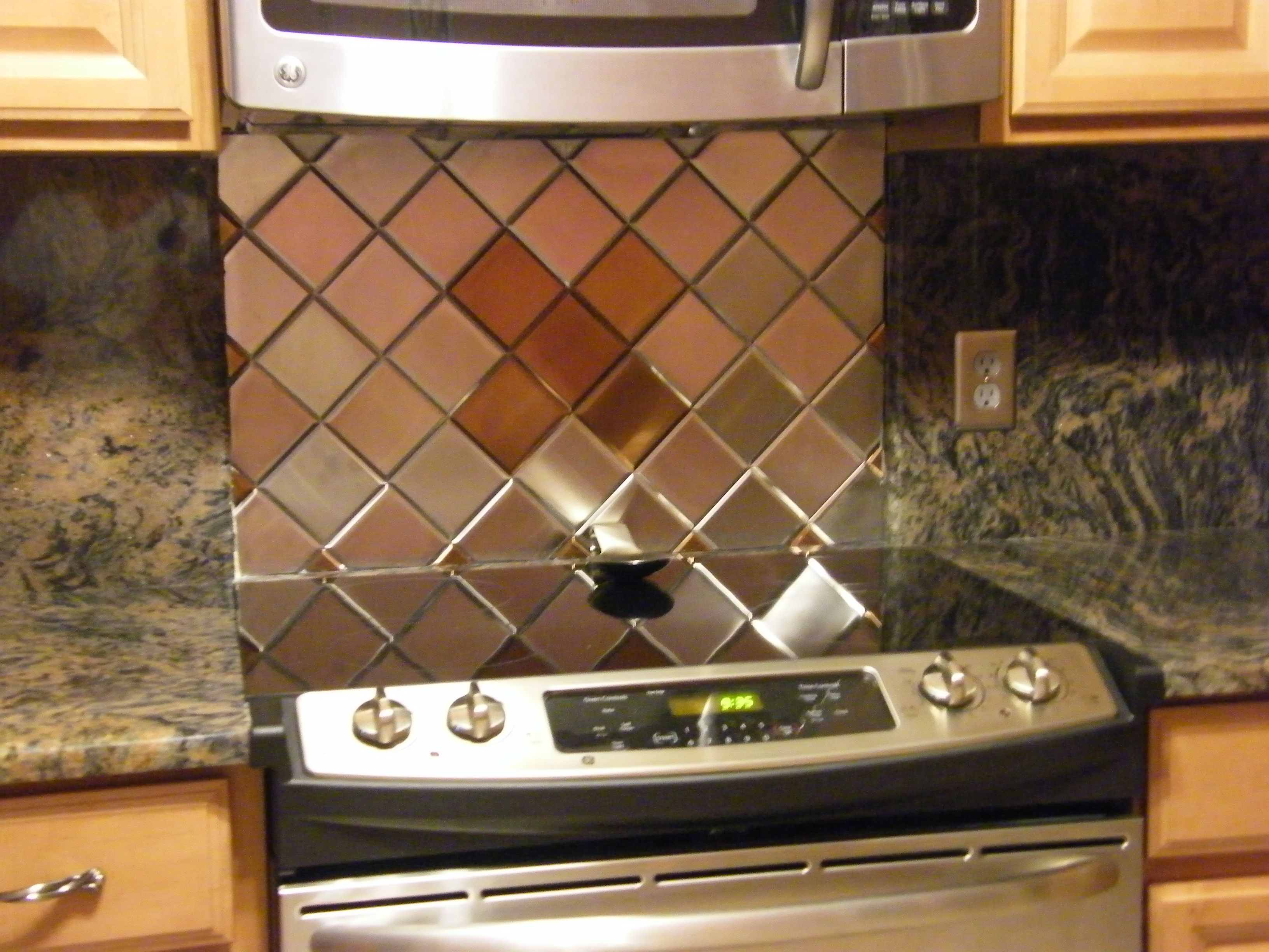 4 x 4 brushed stainless steel backsplash harlequin pattern x brushed stainless steel backsplash harlequin pattern integrated with x copper tiles dailygadgetfo Image collections