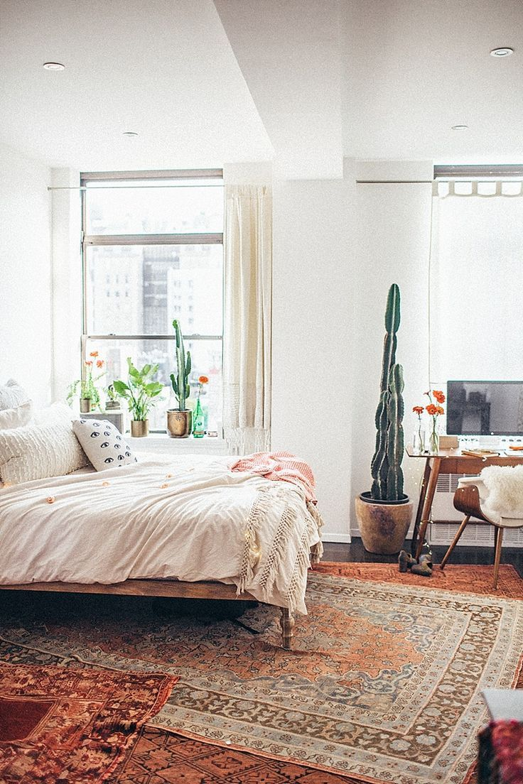 bedroom decor ideas - boho chic with layered rugs, white neutral