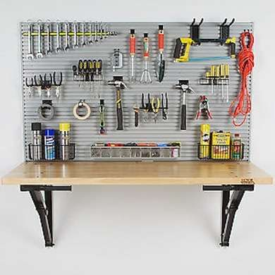 DIY Workbench-folds down when not in use. Great for small garages and workspaces.