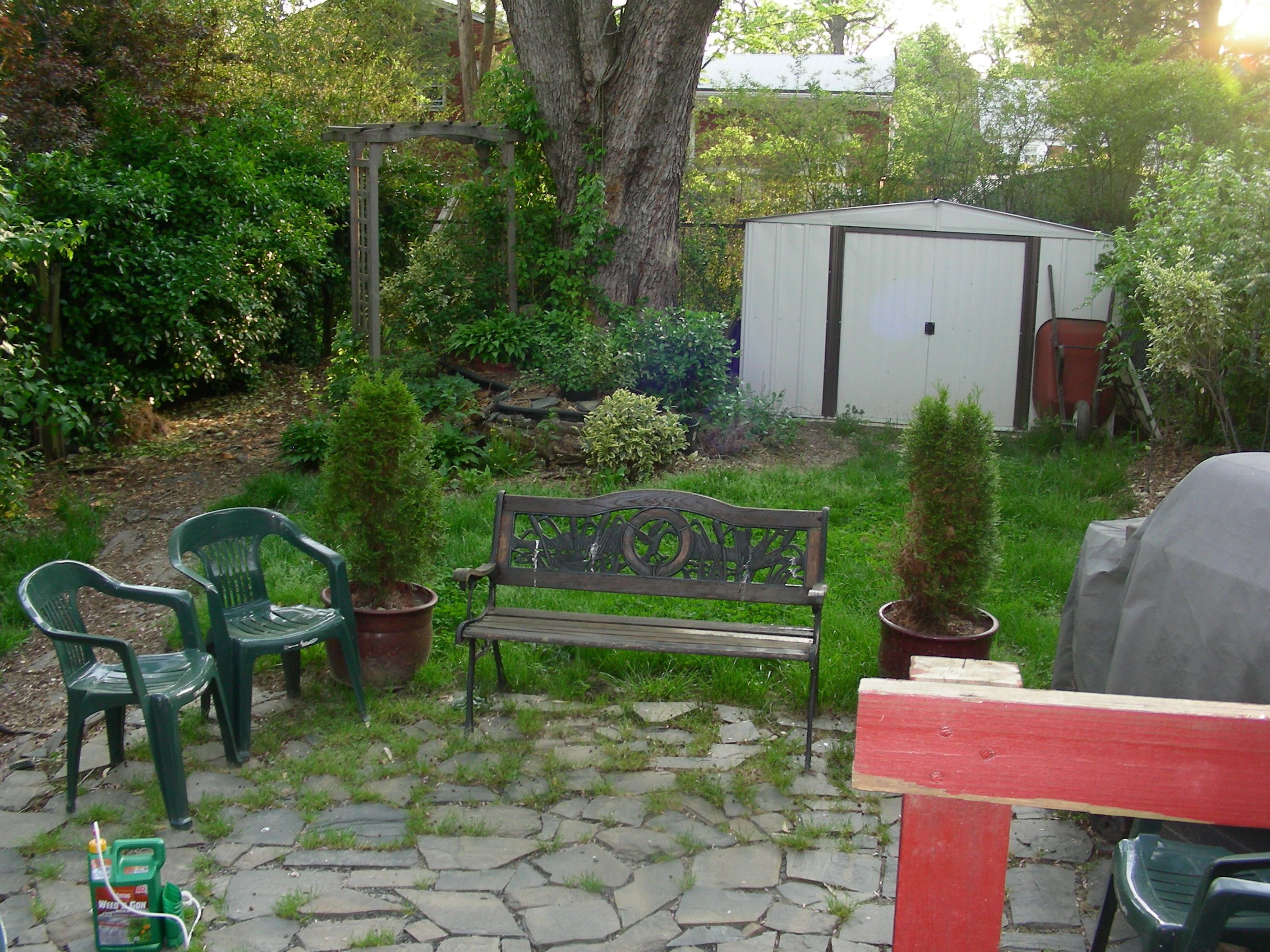 This old backyard was created by building a pond and an area with rocks such as this to relax and enjoy the backyard