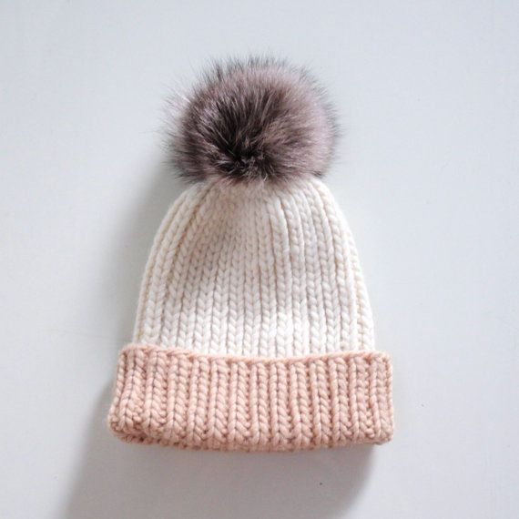c207e9a79ce Pom pom rib knit hat with recycled raccoon fur pom pom that fastens on with  a press stud. Hat can be worn slouchy or cuffed. Hand knitted from soft wool  ...