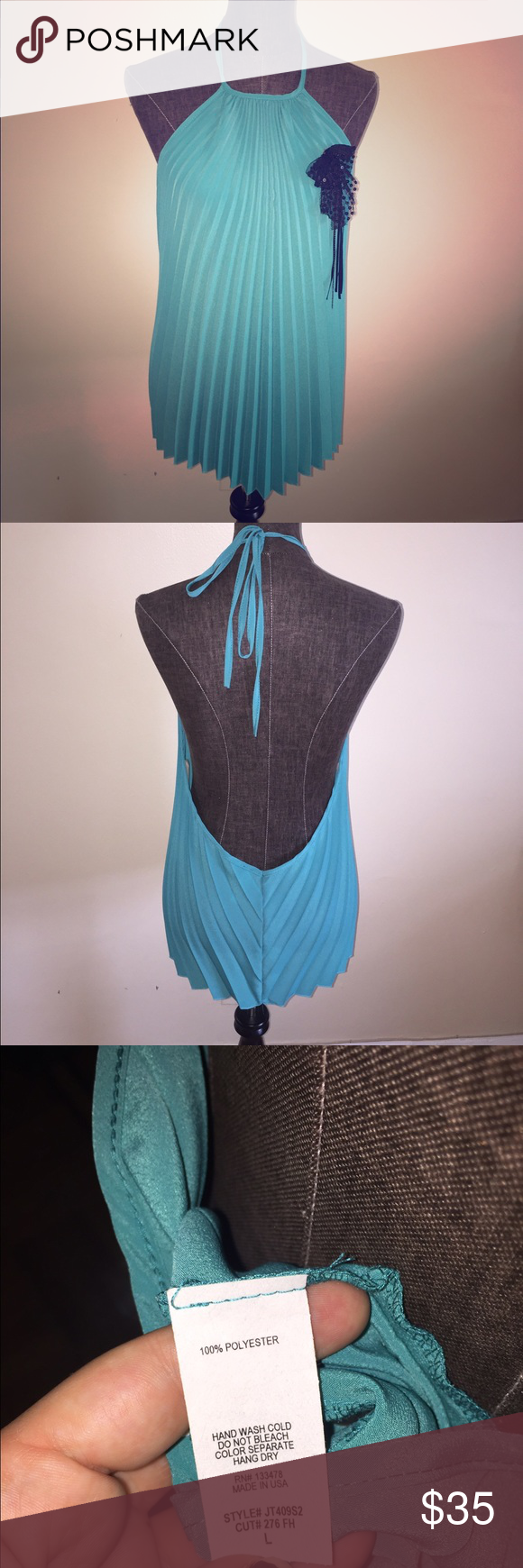 ✨Newly Reduced✨Gorgeous turquoise top!!Never worn! Hot open back top. Size large. Great with skinny jeans or shorts. Tops