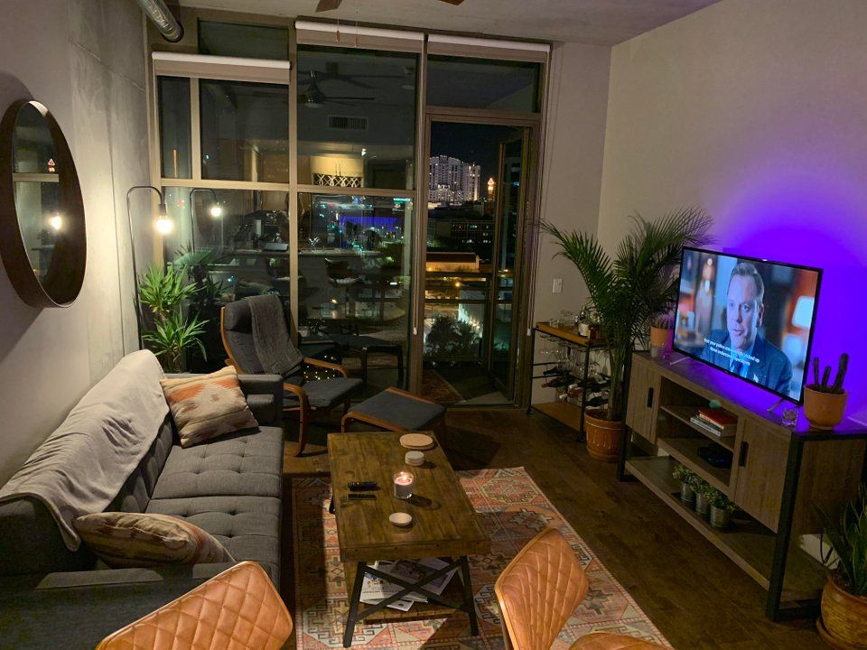 Look How Plants Make It So Livley And Small Trinkets On The Low Coffee Table Like Candles Elevate In 2021 Condo Living Room Apartment Room Small Apartment Living Room