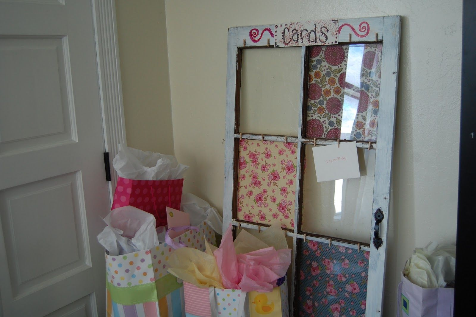 Window cover up ideas  cute idea  safety pins on old window frame to pin up cards  craft