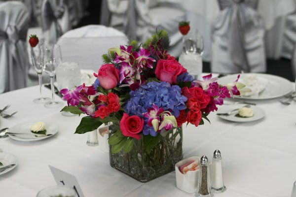 Square vase with royal blue hydrangeas hot pink roses