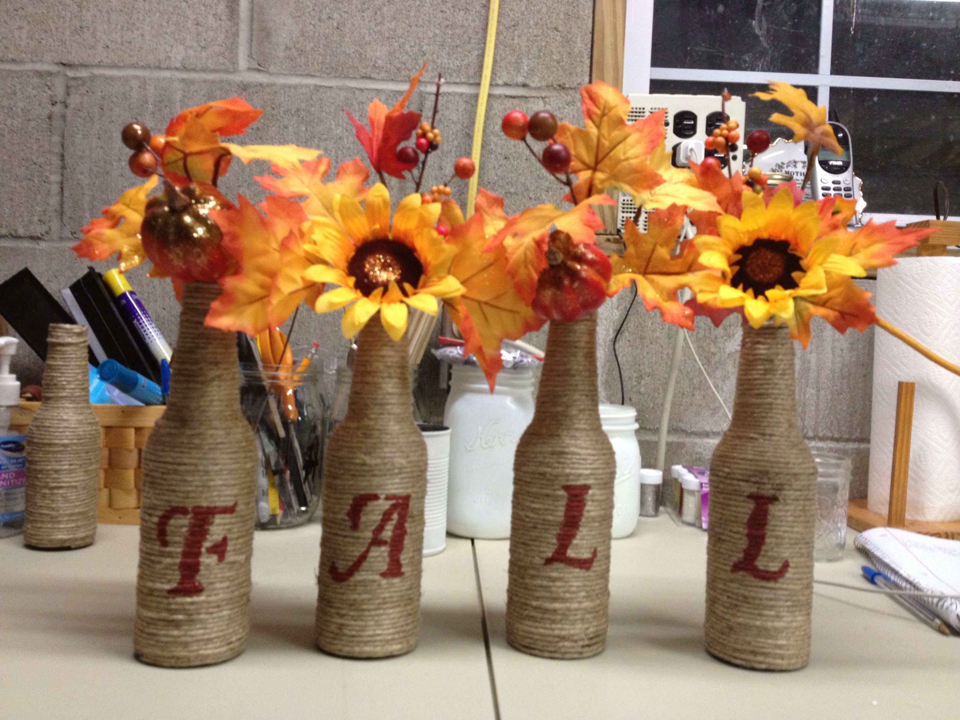 Fall decoration beer bottles wrapped with twine for Beer bottle decoration ideas