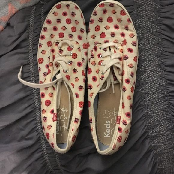Taylor's swift keds worn once! Has floral detailing! Great condition! Shoes