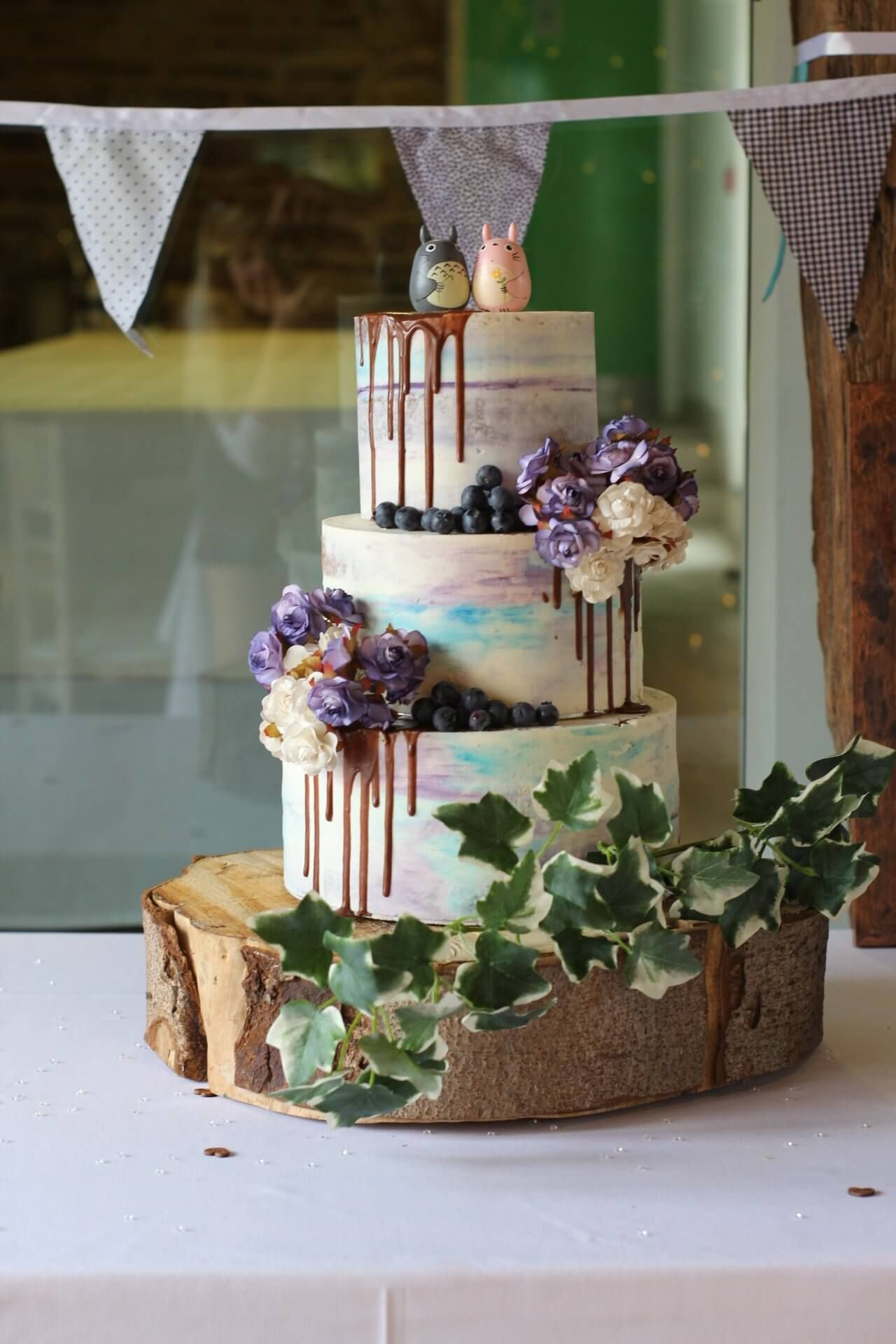 Purple and blue watercolour seminaked wedding cake with faux