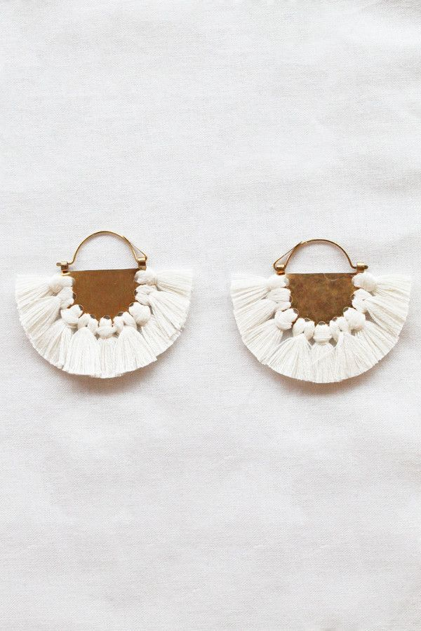 The Hazel Cox Lunar earrings are worth pulling your hair back for.